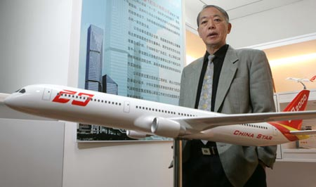 Zhou Jisheng pictured behind a model plane. (Photo/CFP)