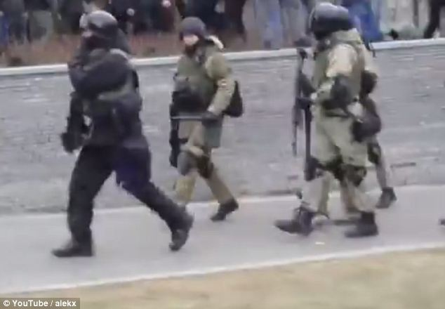 A screengrab from a YouTube video showing armed men on the streets of Donetsk, a largely Russian-speaking city in east Ukraine which has been the scene of large protests against the country's new regime