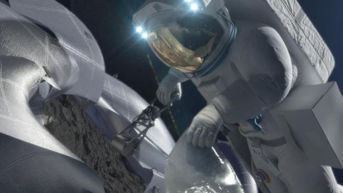 Artist's concept of an astronaut retrieving a sample as part of the Asteroid Redirect Mission.  NASA