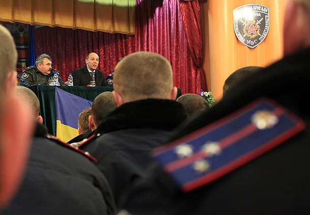 Ukrainian Interior Ministry troops listen to National Security and Defense Secretary Andriy Parubiy speak at an event in March. © Pavlo Podufalov