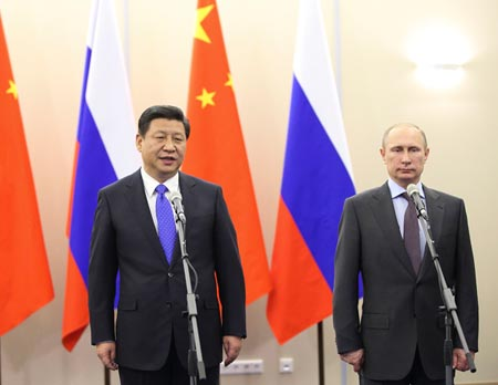 Xi Jinping meets with Vladimir Putin in Sochi at the opening of the Winter Olympics, Feb. 6. (Photo/Xinhua)