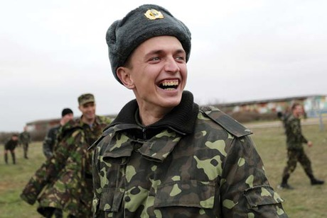 A Ukrainian soldier smiles amid the tense standoff inside the Sevastopol air base in Belbek, Crimea, on March 4.