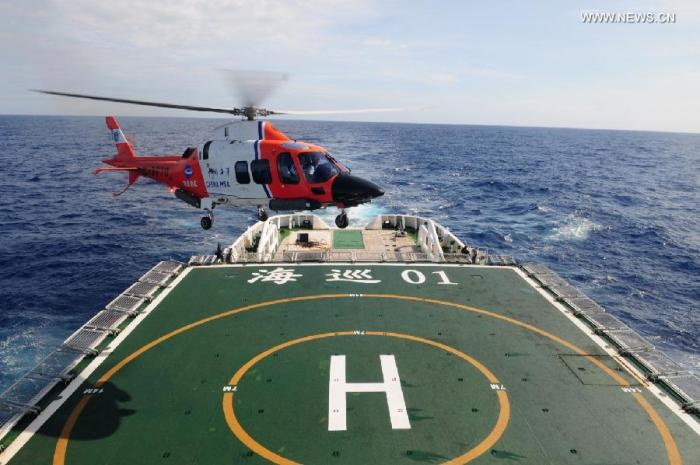 Photo taken on March 21, 2014 shows Chinese patrol ship Haixun 01 searching in souther India Ocean.