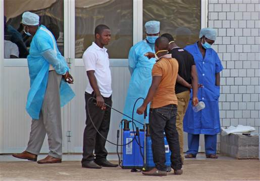 Medical personnel at the emergency entrance of a hospital receive suspected Ebola virus patients in Conakry, Guinea, on March 29.