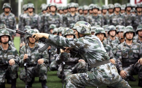 A training officer demonstrates the use of a rifle with a knife extension as cadets watch at the People's Liberation Army Academy of Armored Forces Engineering in Beijing. Photo: EPA