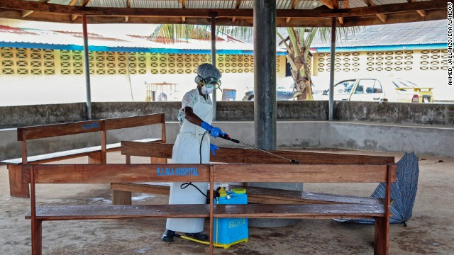 A nurse disinfects the waiting area at the ELWA Hospital in Monrovia, Liberia, on Monday, July 28. Health officials say an Ebola outbreak centered in West Africa is the deadliest ever. As of July 23, 1,201 people in Guinea, Sierra Leone and Liberia are thought to have been infected by Ebola since its symptoms were first observed four months ago, according to the World Health Organization