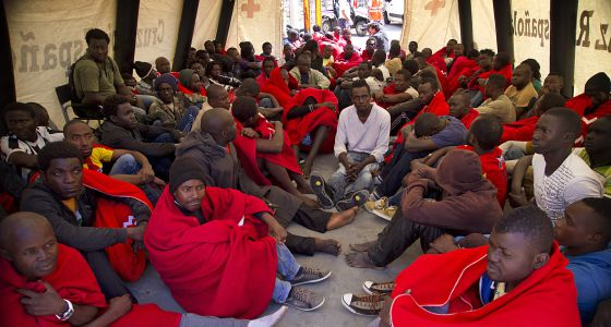 A group of immigrants is treated by the Red Cross in Tarifa (Cádiz) after being rescued. / PACO PUENTES