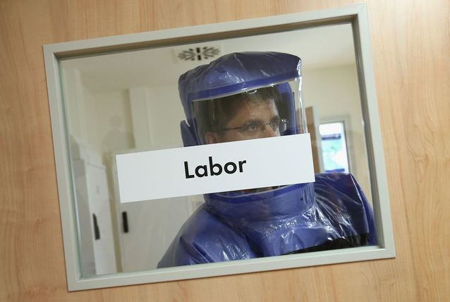 A doctor for tropical medicine leaves a laboratory during a demonstration for the media of ebola treatment capabilities at Station 59 at Charite hospital on August 11, 2014 in Berlin, Germany. The specialized quarantine unit at Station 59 is among a handful of facilities in Germany nationwide that are capable of handling ebola cases. According to media reports a German medical student currently in Ruanda is showing signs of the disease, though should he in fact have ebola it is so far unclear whether he would be flown to Germany for treatment. The disease has so far claimed over 1,000 lives in western Africa in recent weeks. (Getty Images)