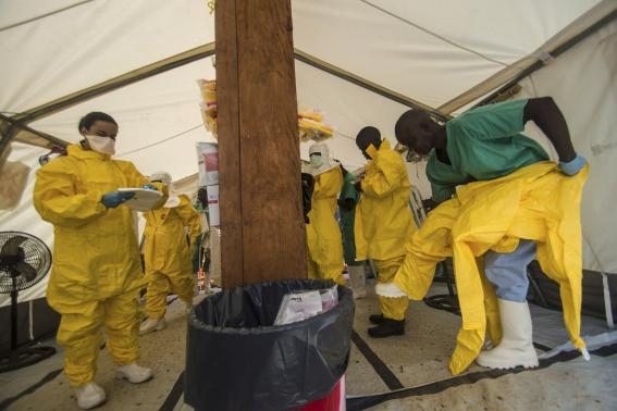 Medical staff working with Medecins sans Frontieres (MSF) put on their protective gear before entering an isolation area at the MSF Ebola treatment centre in Kailahun July 20, 2014. CREDIT: REUTERS/TOMMY TRENCHARD